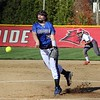 Bethany Christian sophomore Julia Moser (19) throws a pitch in the first inning of Tuesday's game against Goshen.