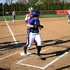 Bethany Christian freshman Mariah Stoltzfus looks toward second base as she touches home plate, scoring the first run of Tuesday's game against Goshen at Shanklin Park in Goshen.
