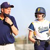 Fairfield coach John Skibbe, left, talks to Kenlee Gall (15) at third base in between pitches midway through Tuesday's game against Central Noble. The Falcons would win 8-4 in eight innings to advance to play Westview on Thursday.