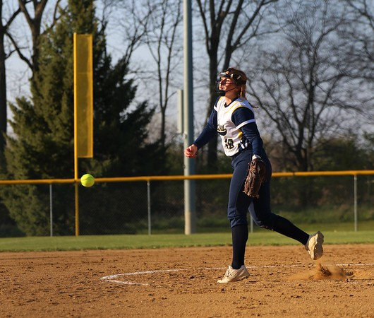 Fairfield senior Kayla Miller (18) tosses a pitch from the circle early against Lakeland during Thursday's game at Lakeland High School in LaGrange.