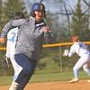 Fairfield senior Laney Faldoe (11) heads to home plate during Thursday's game against Lakeland in LaGrange. The Falcons would win 18-1 in five innings.