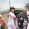 Westview's Jocelynn Schrock, middle, celebrates with teammates after scoring during Monday's NECC Tournament final at Westview High School in Topeka.