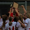 The Westview softball team celebrates after defeating Prairie Heights in the NECC Tournament final on Monday at Westview High School in Topeka.