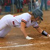 Westview's Addie Bender slides into home during Monday's NECC Tournament final against Prairie Heights at Westview High School in Topeka.