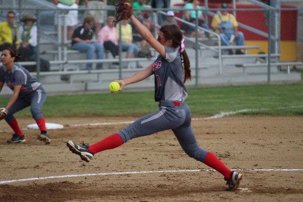 GREG KEIM   THE GOSHEN NEWS<br /> Sophomore pitcher Kate Atkinson of Goshen fires a pitch for the Redskins Wednesday in the Class 4A softball sectional at Elkhart Memorial.