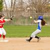 SAM HOUSEHOLDER | THE GOSHEN NEWS<br /> Westview shortstop freshman Hailey Courtney tries to catch the ball as Bethany Christian senior baserunner Mallory Bontreger during the game Friday.