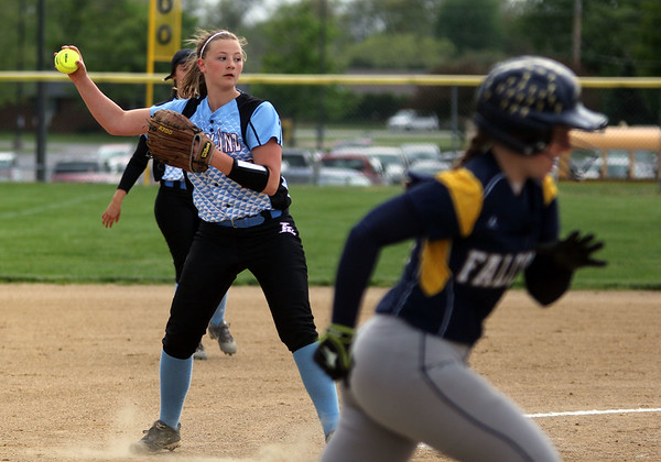 STEPHEN BROOKS   THE GOSHEN NEWS<br /> Lakeland freshman pitcher Elise Edwards, left, looks to throw a Fairfield runner out at first base during Monday's NECC game at Fairfield. Fairfield won 4-0.