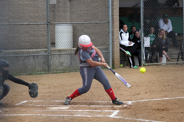 GREG KEIM | THE GOSHEN NEWS<br /> Freshman Ashton Darnell follows through with her swing at a pitch for the Goshen RedHawks in a high school softball game Wednesday at Concord.