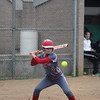 GREG KEIM | THE GOSHEN NEWS<br /> Sophomore Elkah DeVoe of the Goshen RedHawks eyes a pitch during a high school softball game Wednesday at Concord.