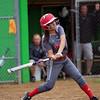 GREG KEIM | THE GOSHEN NEWS<br /> Senior Emily Castillo of the Goshen RedHawks swings at a pitch in an NLC high school girls softball game against the Northridge Raiders Thursday in Middlebury.