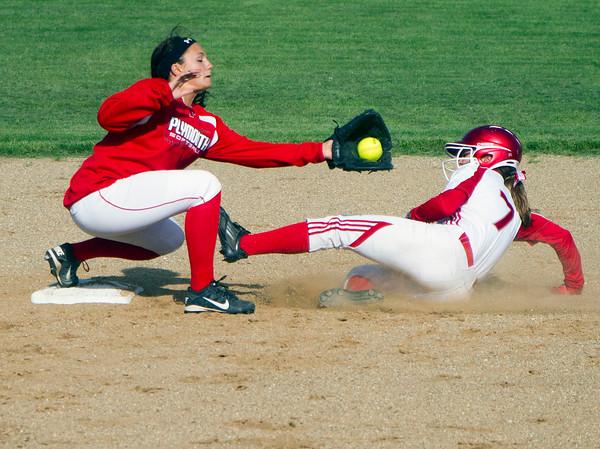 SAM HOUSEHOLDER | THE GOSHEN NEWS<br /> Goshen senior Brooke Miller slides into second as Plymouth second baseman Jillian Smith catches the ball during the game Wednesday at Shanklin Park.