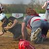 SAM HOUSEHOLDER   THE GOSHEN NEWS<br /> Goshen senior catcher Jessica DeStefano tries to tag out Northridge sophomore Kylee Lantz during the game Wednesday.