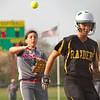 SAM HOUSEHOLDER   THE GOSHEN NEWS<br /> Goshen sophomore third baseman Emily Castillo throws the ball to home to get out Northridge senior Taylor Long during the game Wednesday.