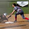 SAM HOUSEHOLDER   THE GOSHEN NEWS<br /> Goshen third baseman sophomore third baseman Emily Castillo tries to tag out Northridge senior Grace Grevengoed during the game Wednesday.