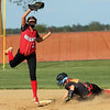 JAY YOUNG | THE GOSHEN NEWS<br /> Westview's Adrianna Wilson slides safely into second base as Prairie Heights' Shelby Fish has to leap to pull down the throw during their sectional game Monday evening in Topeka.