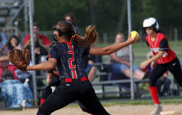 JAY YOUNG | THE GOSHEN NEWS<br /> Westview pitcher Andrea Stoltzfus (2) pitches out of a jam with Prairie Heights' Trelynn Tschannen on third base during the sixth inning of their sectional game Monday evening in Topeka.