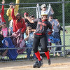 JAY YOUNG | THE GOSHEN NEWS<br /> Westview's Megan Schrock (5) celebrates as the home crowd reacts behind her after she scored the game-winning run against Prairie Heights in the seventh inning of their sectional game Monday evening in Topeka.
