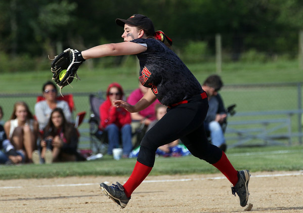 JAY YOUNG   THE GOSHEN NEWS<br /> Westview shortstop Hayley Courtney charges to catch a fly ball during the Westview's sectional game against Prairie Heights Monday evening in Topeka.