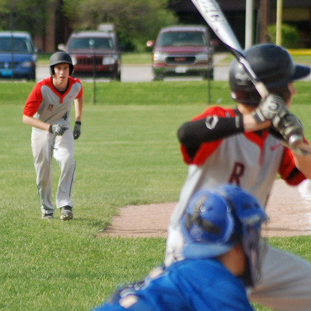 Aaron Kirchoff/Rushville Republican<br /> Rushville's Caleb Wiles takes a lead off third with Nick Sprinkle at the plate during the Lions' 6-2 loss to No. 1 Greensburg.