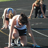 Aaron Kirchoff / Rushville Republican<br /> Rushville's Jordan Linville gets set in the blocks at the start of the 400-meter relay during the Lady Lions' meet with Shelbyville.