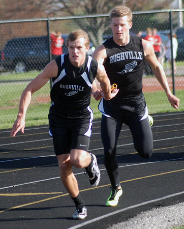 Aaron Kirchoff/Rushville Republican<br /> Rushville's Zach Turner hands off to Keith Yager during the 400-meter relay.