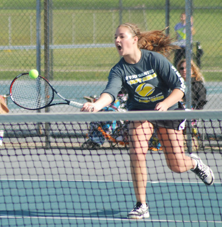 Aaron Kirchoff / Rushville Republican<br /> Rushville senior Allison Wainwright charges in on a short ball during action at No. 1 singles in the Rushville Invitational Saturday. Wainwright went 3-0 on the day as did the Lady Lions as they claimed the team title.