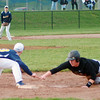 Back in time<br /> Aaron Kirchoff / Rushville Republican<br /> Rushville's Michael St. John dives back safely to first base in the Lions' victory over Shenandoah. The Lions opened the season with victories over the Raiders and Edinburgh.