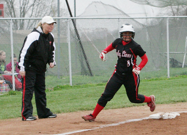 Kate Thurston / Rushville Republican<br /> Rushville senior Kylie Martindale rounds third during action at Connersville.