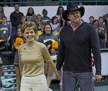 Trace Adkins was an old friend of Coach Mulkey from their college days at LSU. He was her guest at the game and he sang the National Anthem.