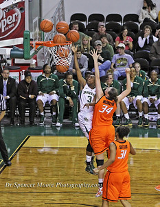 Baylor's Jordan Madden, #3, is making a lay-up shot for another 2 points against OSU.