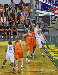 Brittney Griner completes a lay-up shot from behind the backboard in the game against OSU.