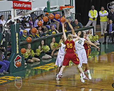 "6"" 8"" Brittney Griner blocks #55, Iowa State's 6' 7"" player and this sequence shot shows the track out the ball as goes out of play."