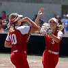 St. Anthony's Addie Wernsing (3) and Sydney Kibler (10) prepare to high-five after getting out of the first inning during a softball game against Marissa (Coulterville) in the Class 1A Super-Sectionals, Monday, June 14, 2021, at Johnston City High School, in Johnston City, Illinois. (Alex Wallner/Effingham Daily News)