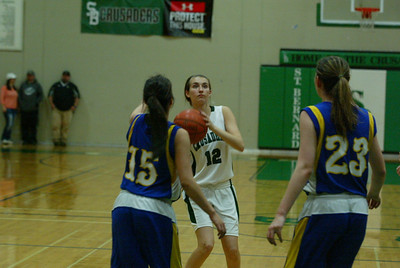 St. Bernard's Paige Legaz puts up a deep jumper after a series of passes left her wide open. She finished with 14 points.