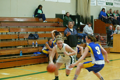 Point Arena head coach Leonard Bechtol, center, is isn't pleased with the defensive effort against St. Bernard's Becca Parker. Parker ended up with an easy layup after driving past the defender.