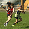 NM Molly O'Neill breaks away with St B's Alana Keating chasing