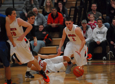 St. Charles rivals battle in basketball