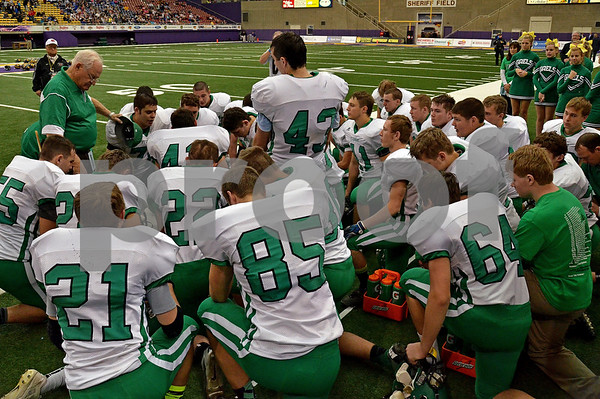 -Messenger photo by Britt Kudla<br /> After losing 35-0 to Iowa City on Friday at the UNI Dome, The St. Edmond Gaels took a second to pray as a team