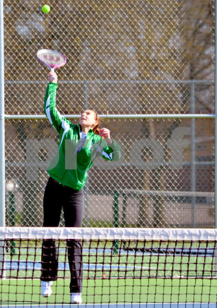 - Messenger photo by Britt Kudla       <br /> St. Edmond's Claire Crimmins serves during Saturday game against Webster City at Dodger's Courts