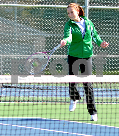 - Messenger photo by Britt Kudla       <br /> St. Edmond's Claire Crimmins returns the ball during Saturday game against Webster City
