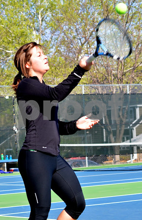 - Messenger photo by Britt Kudla       <br /> St. Edmond's Ellen Chalstrom hits the ball during the tennis match against Webster City