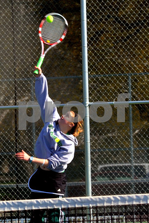 Messenger photo by Britt Kudla<br /> St. Edmond's Mary Eide serves during the tennis match against Webster City on Saturday