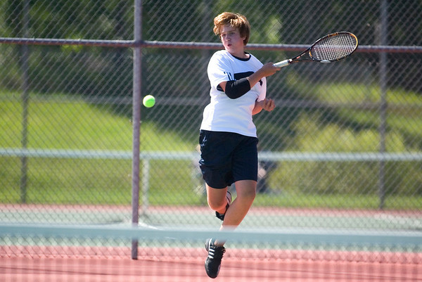 Record-Eagle/Jan-Michael Stump<br />  St. Francis' Mac Hughes serves in his no.1 singles match against Leelanau's Pedro Machado during Wednesday's Traverse City St. Francis Invitational.