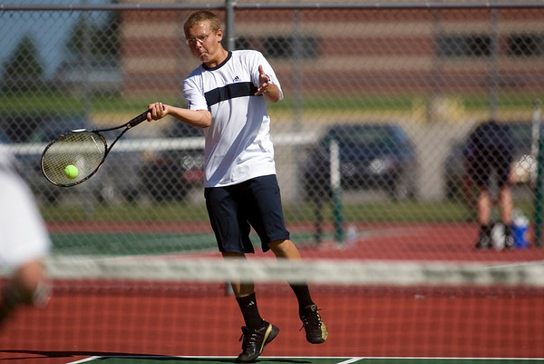 Record-Eagle/Jan-Michael Stump<br /> St. Francis' Newton Calcutt volleys during his no.1 doubles match with Sean Paquett (not pictured) against Leelanau's Wyatt Smith and Caleb Abbott in Wednesday's Traverse City St. Francis Invitational.