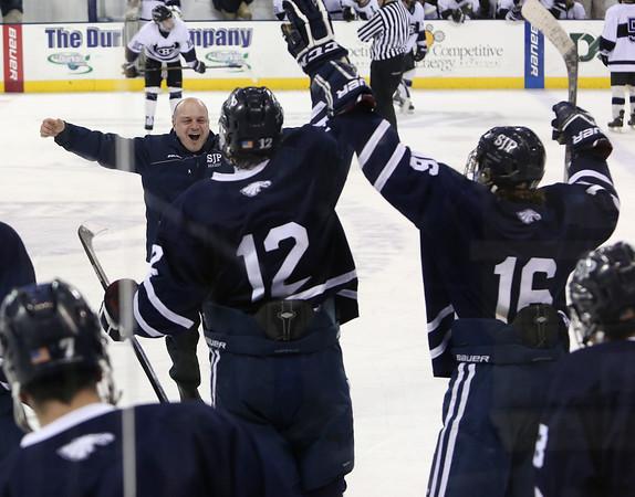 KEN YUSZKUS PHOTO: St. John's Prep head coach Kristian Hanson rejoices on the ice after St. John's Prep won the St. John's Prep vs Springfield Cathedral semifinals.