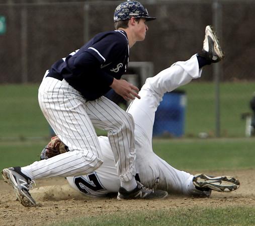 KEN YUSZKUS/Staff photo.  St. John's Prep's Dan Trulli tags Peabody's Tanner Moquin who tried to steal 2nd base at the St. John's Prep vs Peabody baseball game.     04/23/15