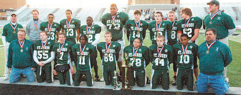St. Jude Varsity Green's seventh- and eighth-grade Division I CYO championship football team: front row, left to right, assistant coach Dennis Carson, Danny Brenner, Jacob Kuchta, Orlando Diggs, Jordan Wolf, Andres Torres, Will Lacinak, Justin Taylor and assistant coach Dan Petticord. Back row, left to right, head coach Brian Hoagland, assistant coach Jeff Buchanon, Miles Flowers, Devin Green, Rickey Avery, De Adam Hall, Jack Klingshirn, Grant Williams, Zach Sudnick, Dan Petticord and assistant coach Steve Wolf.