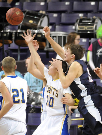 Pat Christman<br /> St. Peter's Kolin Bartlett reaches over Le Sueur-Henderson's Bradley Rose while reaching for a rebound during the second half of their Section 2AA championship game Friday at Bresnan Arena.