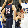Pat Christman<br /> St. Peter's Nick Rosburg concentrates on a free throw during the second half of their Section 2AA championship game Friday at Bresnan Arena.