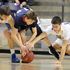 Pat Christman<br /> St. Peter's Aaron Leeb, middle, is surrounded by Le Sueur-Henderson's Jordan Kahlow, left, and Bradley Rose as they dive for a loose ball during the first half of their Section 2AA championship game Friday at Bresnan Arena.